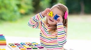 kid playing with colorful letters