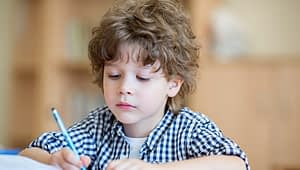 little boy focused on learning