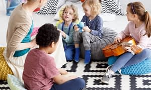 group of kids learning music