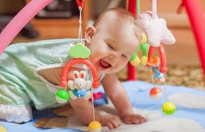 baby playing with toys, happy baby